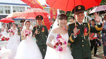 Armed police officers have group wedding in Weizhou Island, south China
