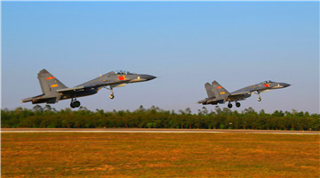 Air force under PLA Southern Theater Command conducts flight training
