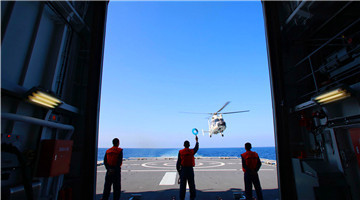 Ship-borne helicopter practices landing skill during far-sea training
