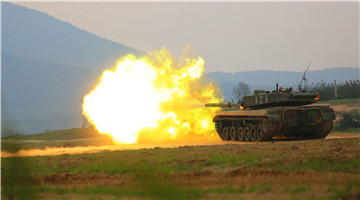 Type-96 MBTs fire at simulated targets