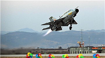 J-7 fighter jets leave for night flight training