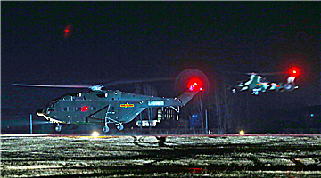 Multi-type helicopters train at night