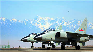 JH-7 fighter bombers fly near Tianshan Mountains