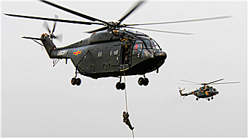 Special operations soldiers fast-rope from Z-8 helicopter