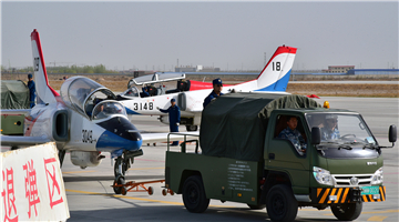JL-8 jet trainers fire aircraft guns