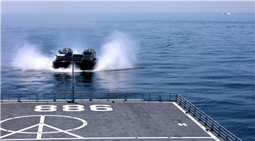 LCAC steers into well deck of dock landing ship