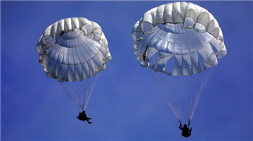 Paratroopers descend to drop zone