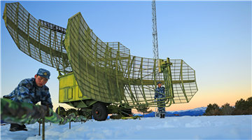 Soldiers check radar systems after heavy snow