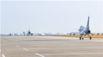 J-10 fighter jets taxi on the flightline