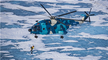 Air force personnel simulate rescue and recovery operations