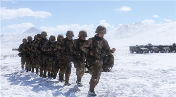 Infantrymen carry out field shooting drill in low temperature and high altitude area