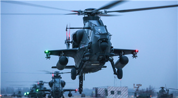 WZ-10 attack helicopter receives power-on inspection at night