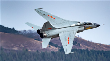 JH-7 fighter bombers soar through valley