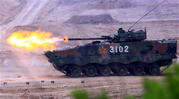 Armored vehicles provide suppressive fires against mock enemies