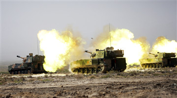 Self-propelled howitzer systems spit fires