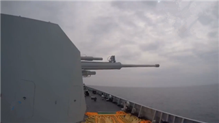 China's guided-missile destroyer conducts live-fire drills